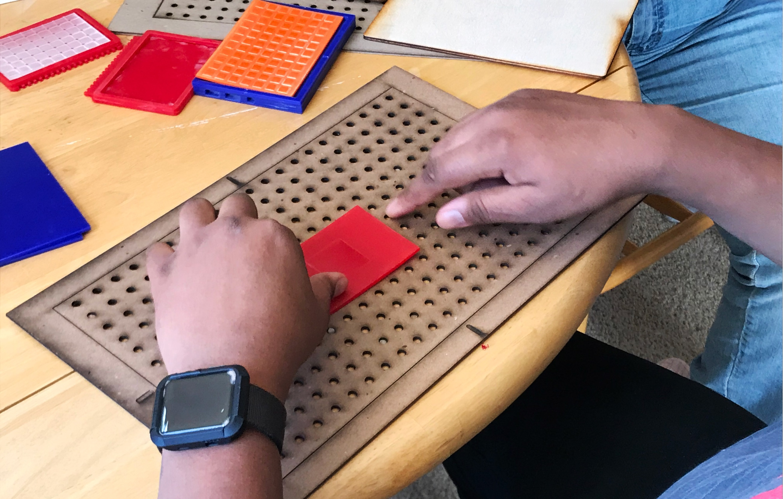 Image showing Participant trying different gridlines and trying to draw with a finger.