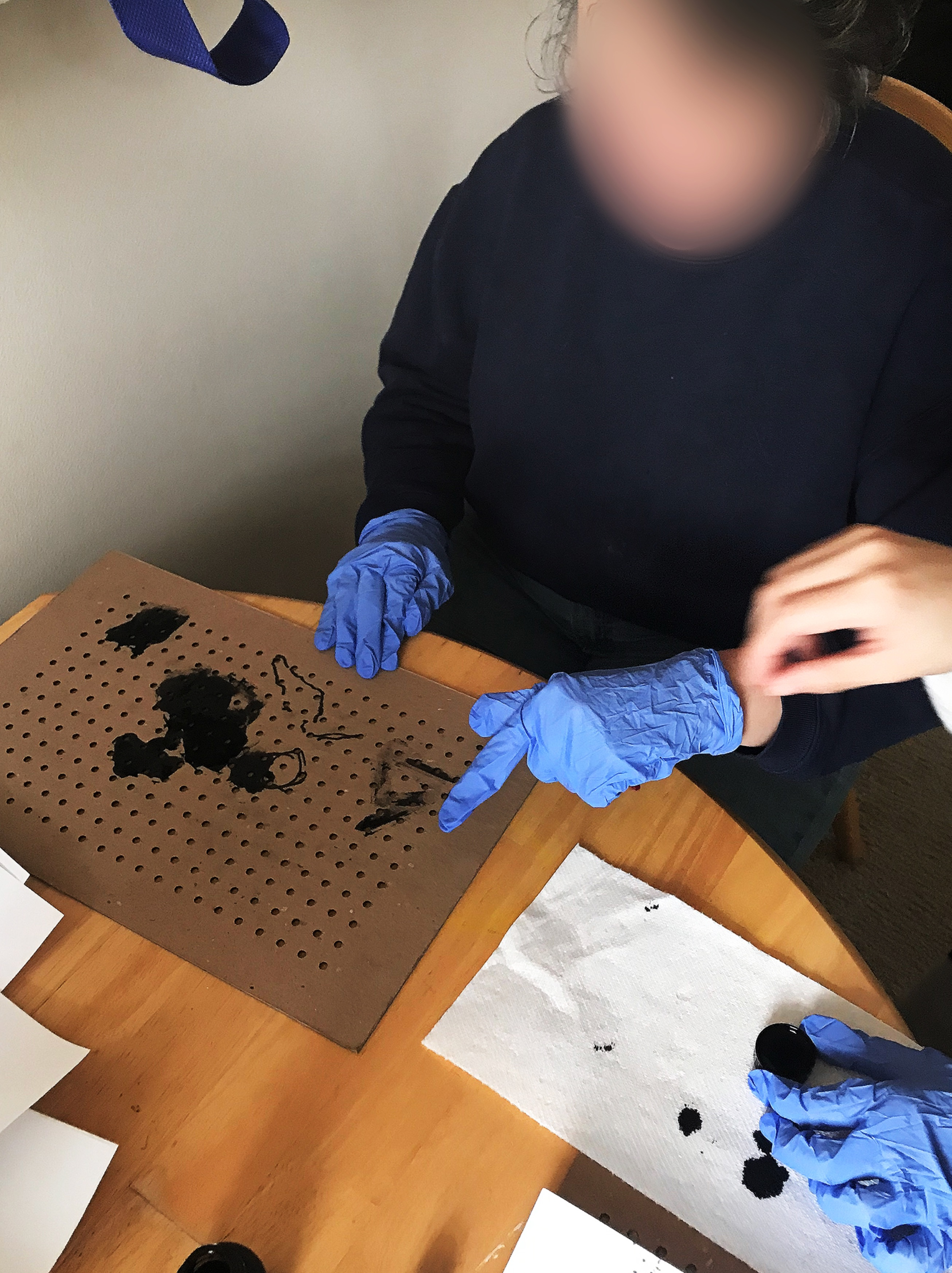 Contextual Inquiry image showing a visually impaired participant who has difficulty drawing with fingers because of difficulty with motor skills.
