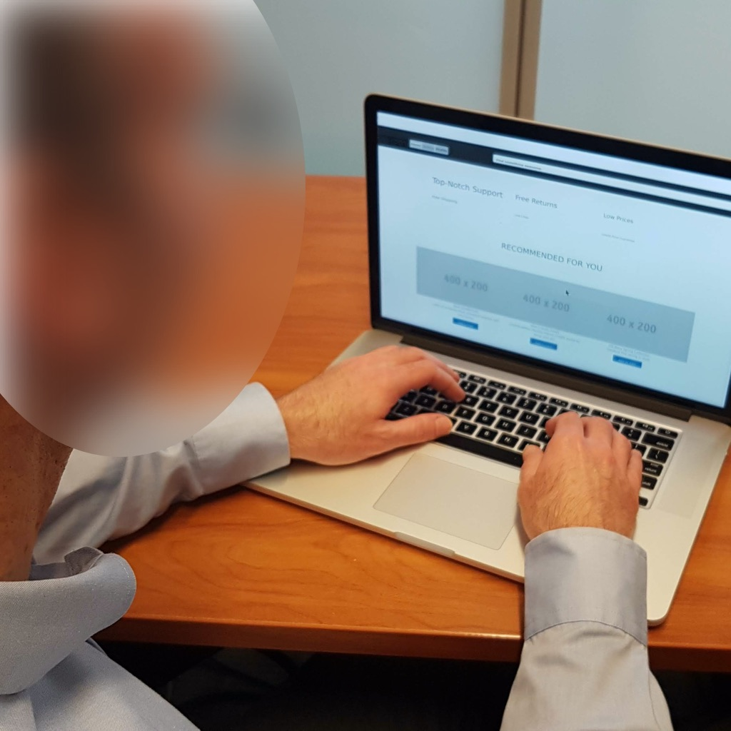 Image of a visually impaired interviewed while using the computer.