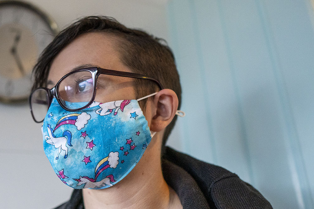 Young Woman Wearing Face Mask Made From Unicorn Fabric