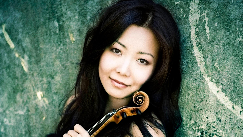 Concert Violinist Susanne Hou holding her violin.