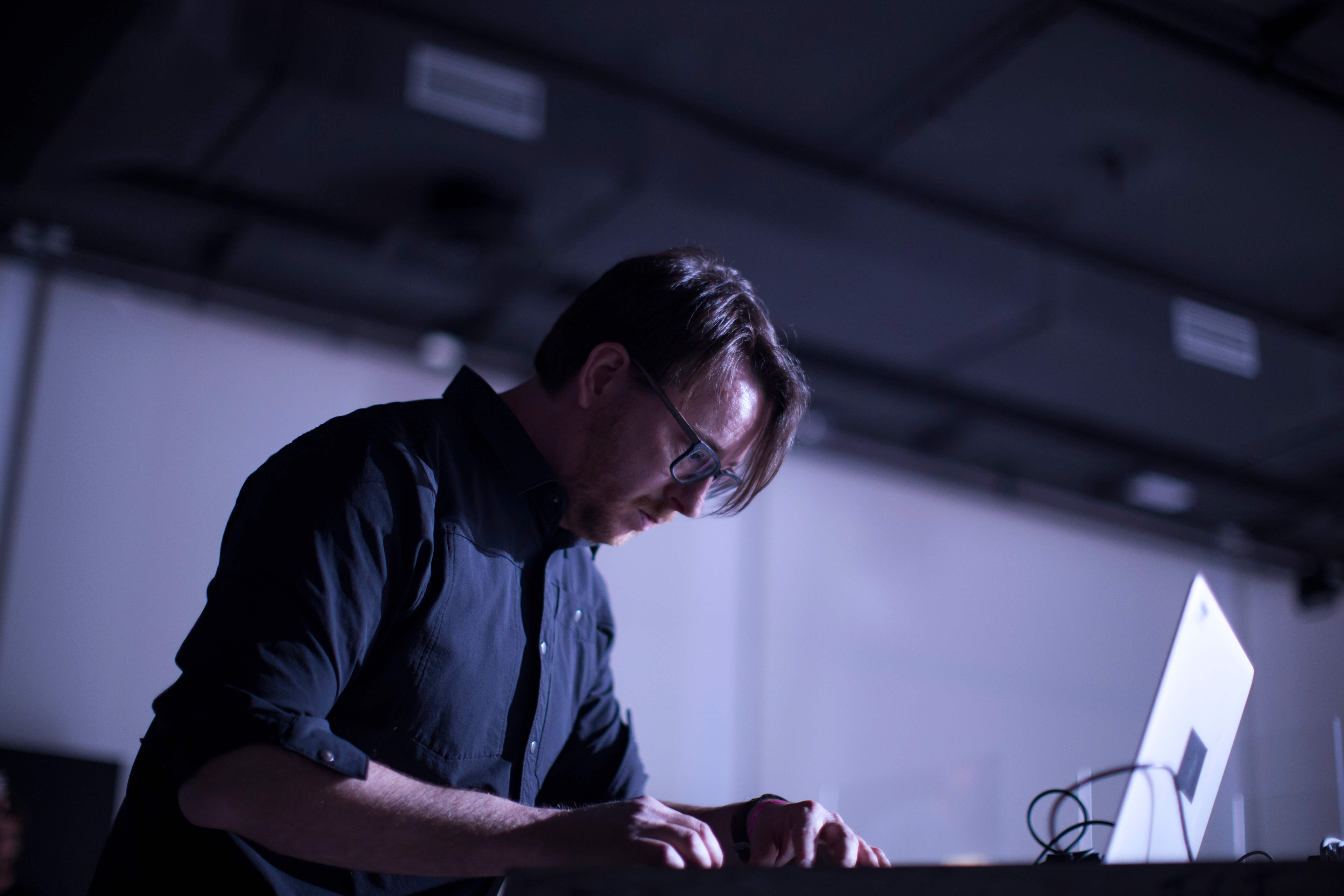 Performer of experimental music Nicolas Bernier and his laptop.