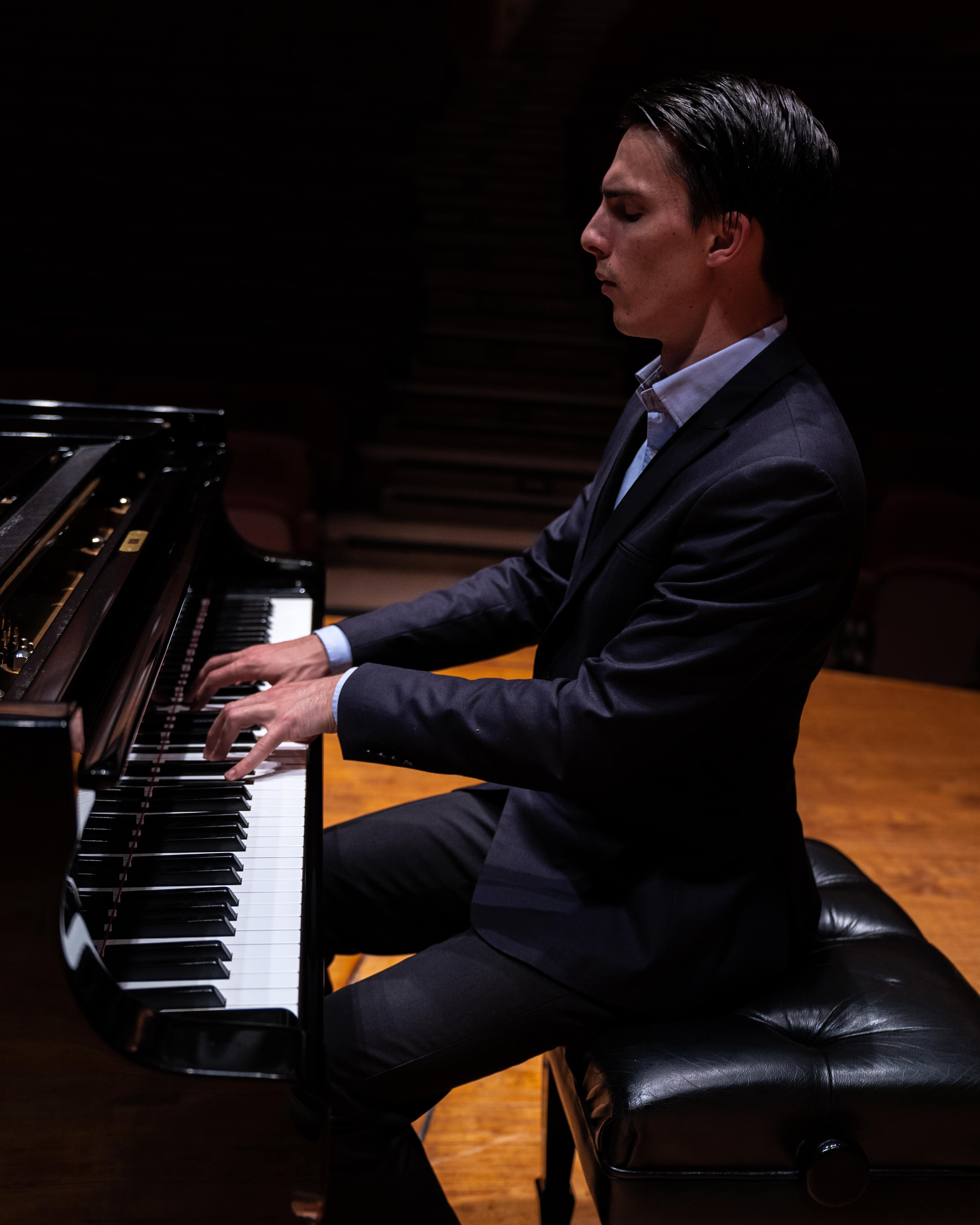 A famous pianist playing with impeccable technique.