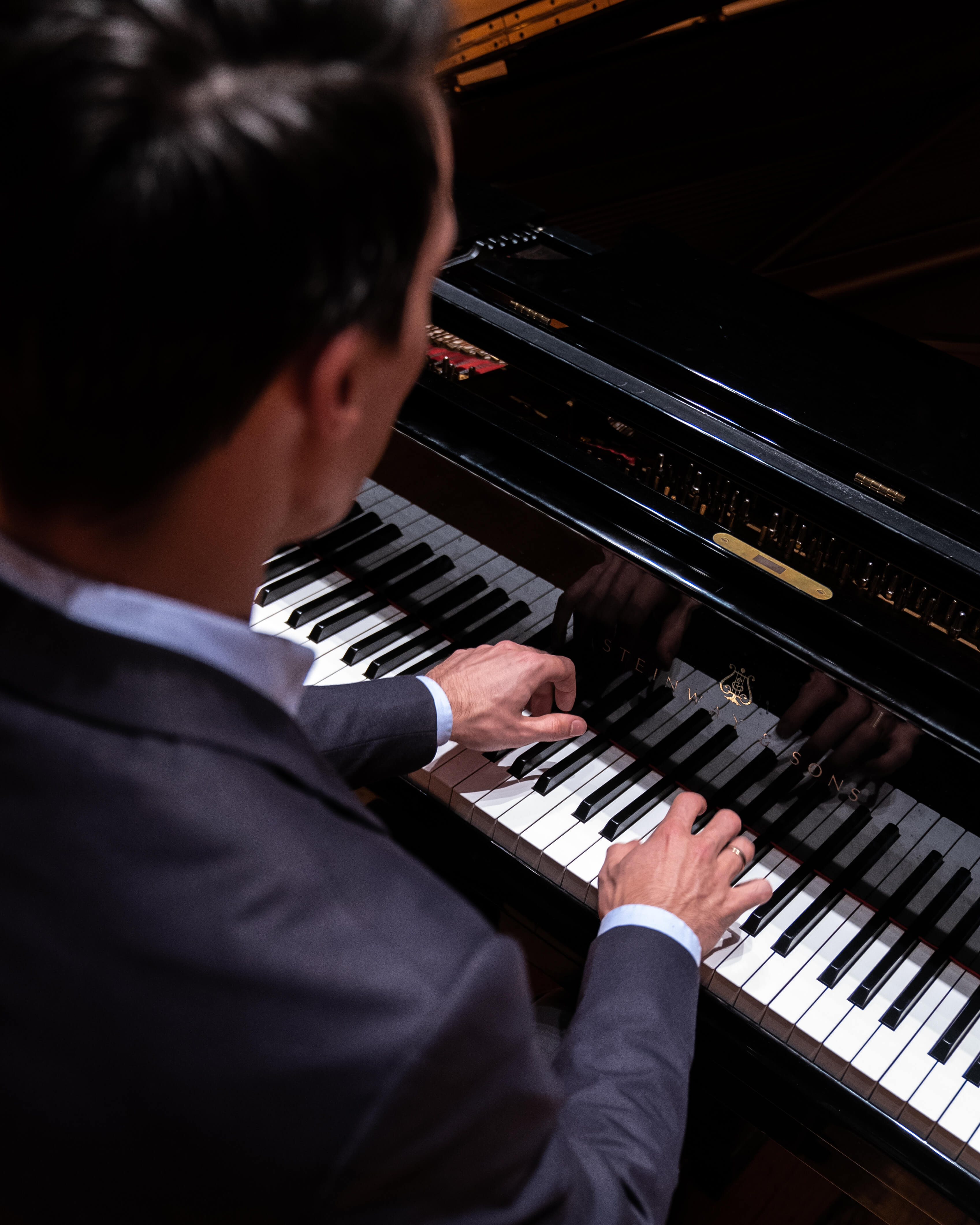 A Steinway Grand being played by a virtuoso pianist.