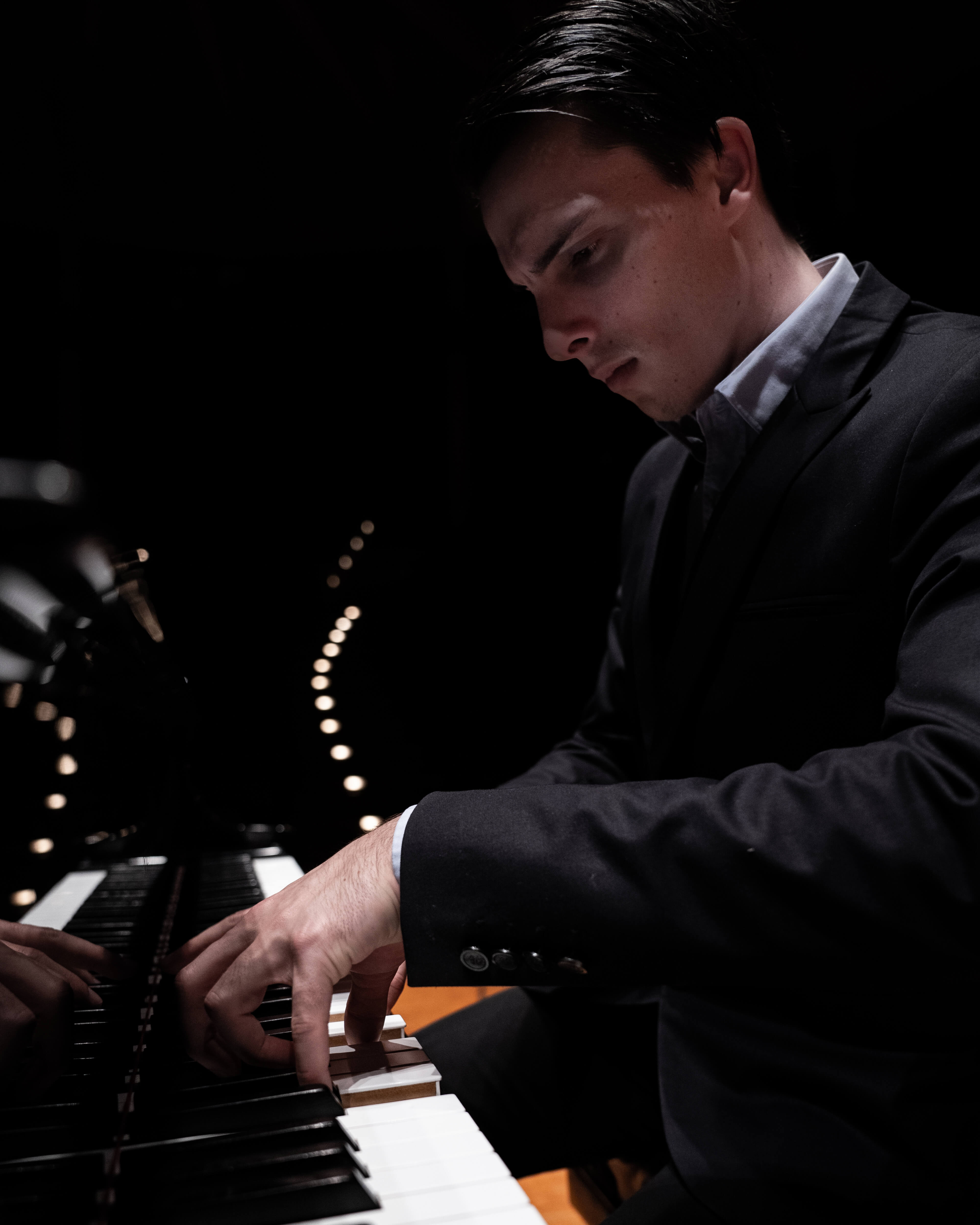 Pianist expressing himself while playing beautiful music.