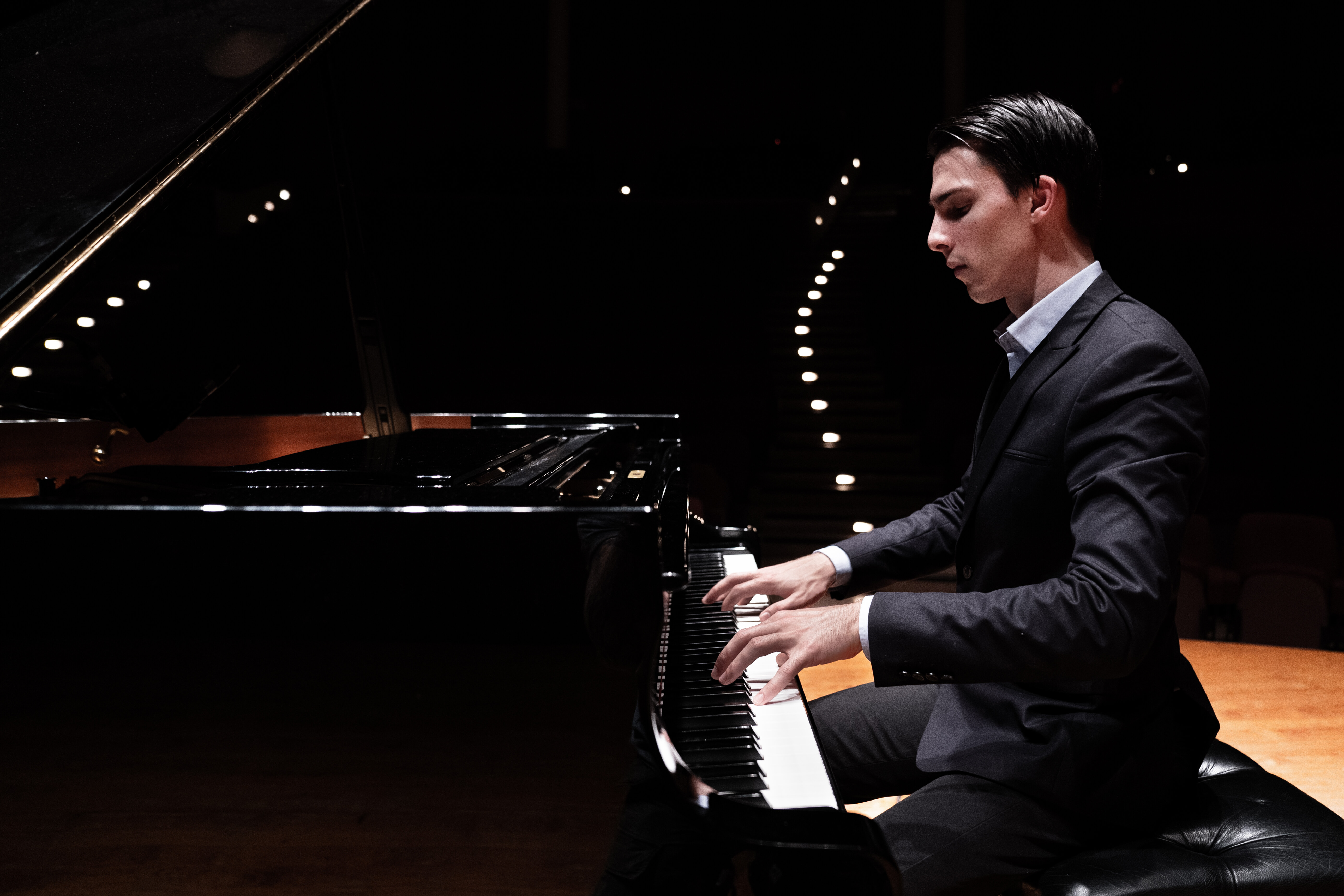 Performer, teacher and composer Liam Pitcher improvising at the piano.