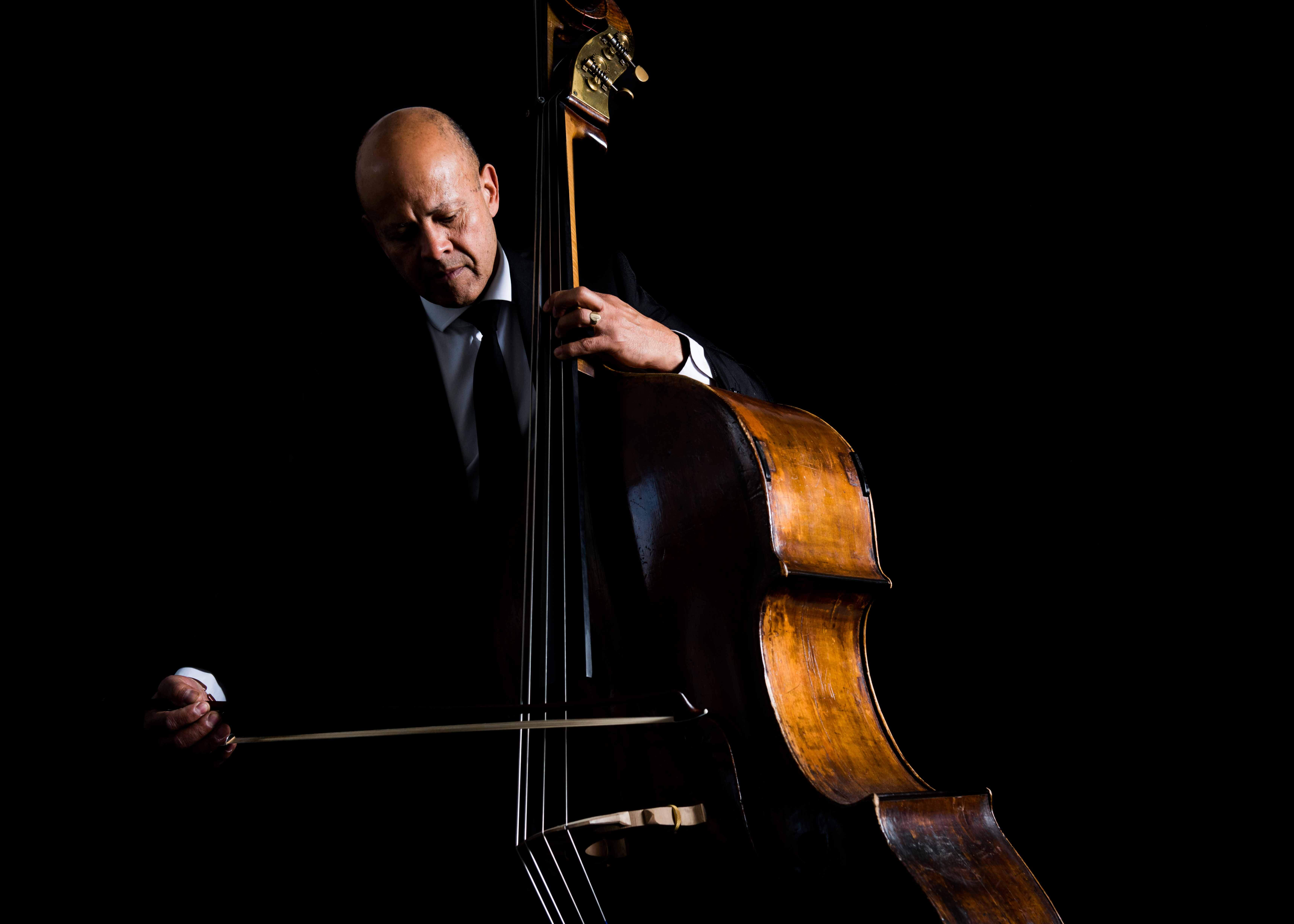 Famous Double Bassist Leon Bosch playing his instrument in the dark.