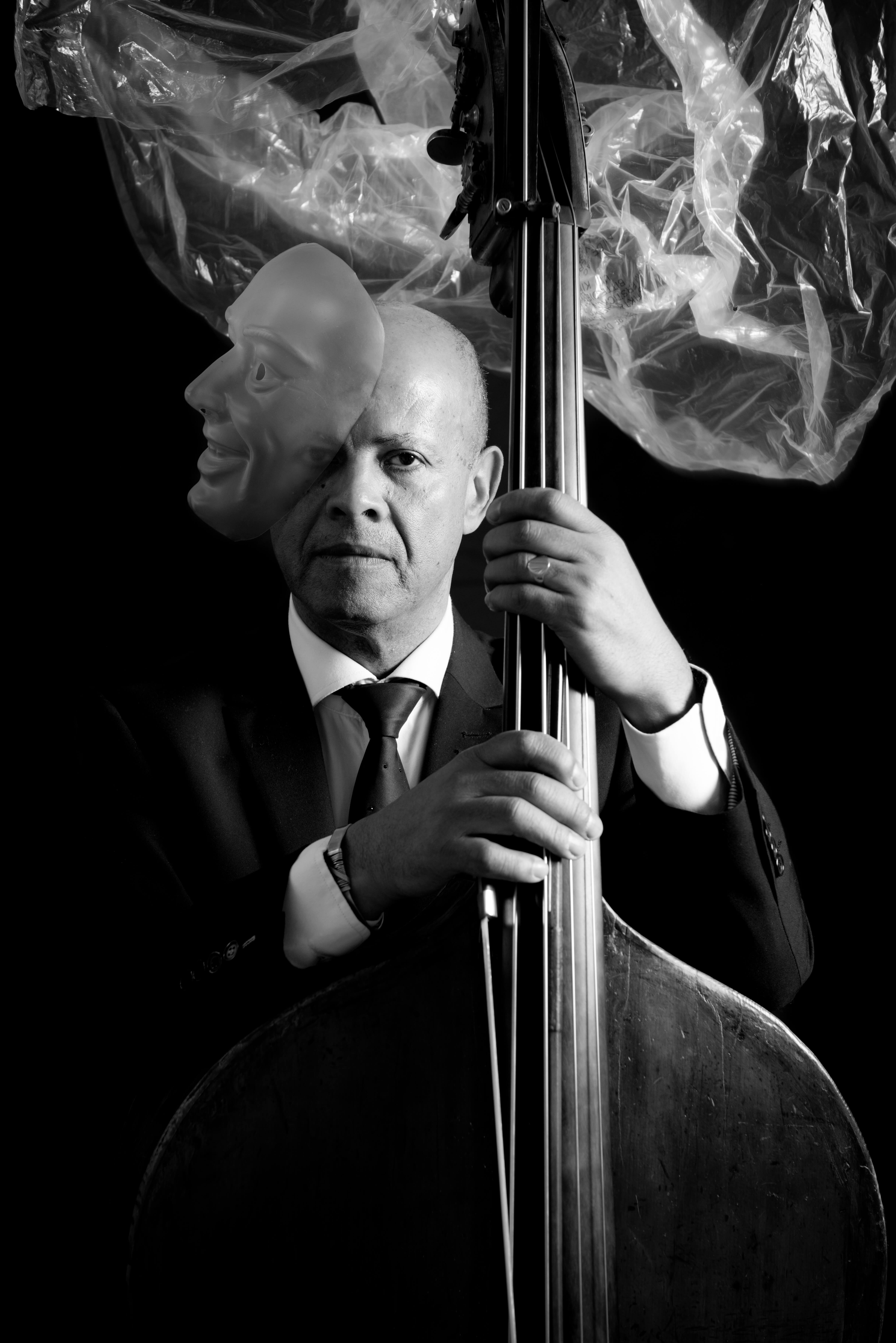 World's best double bass player with plastic and a mask.