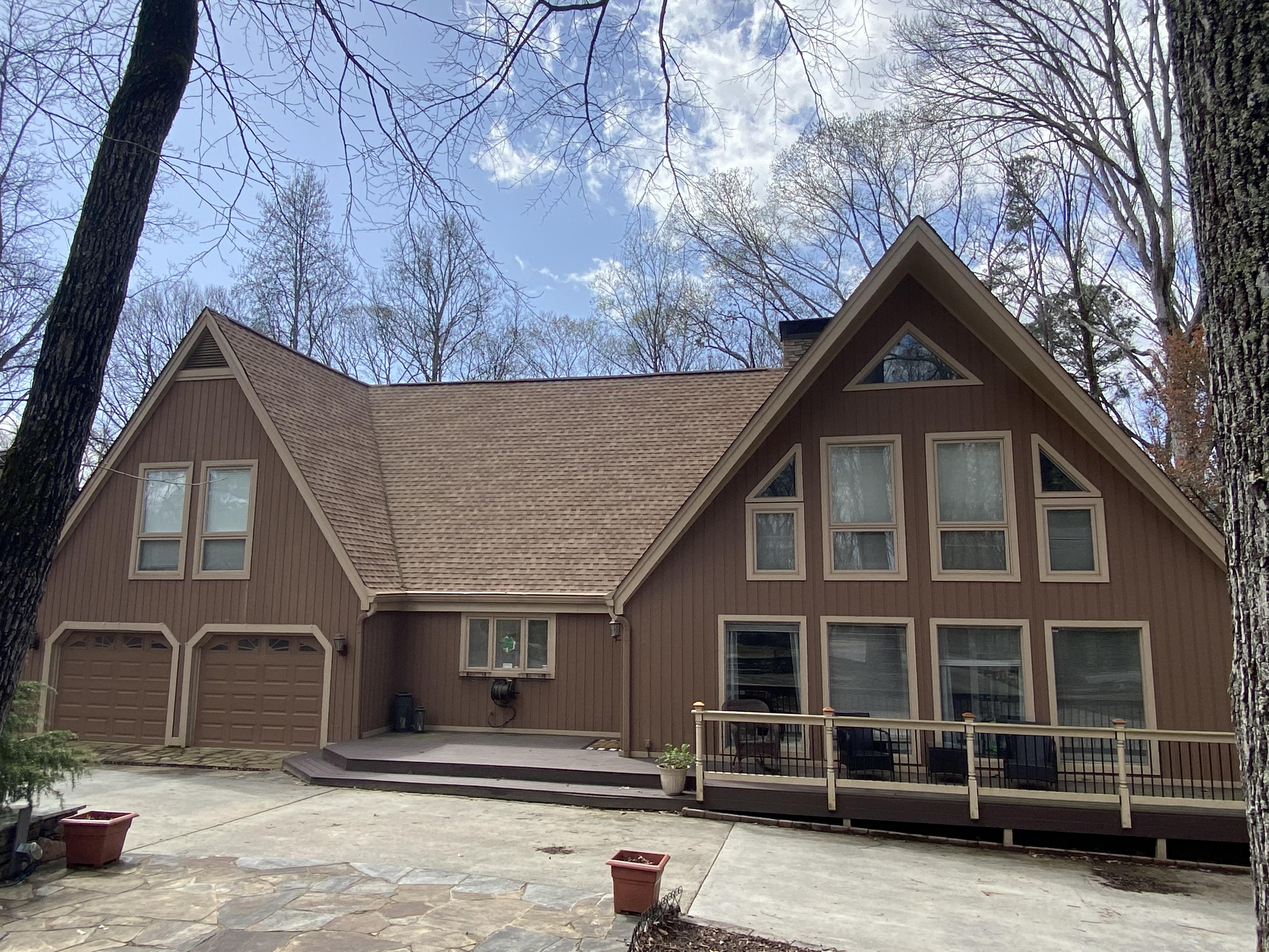 Cedar Siding Home Multiple windows and deck