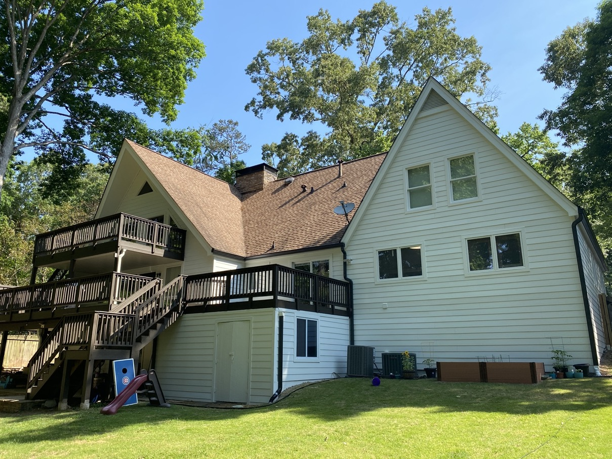 Roswell Smooth Siding Home Multiple windows and deck