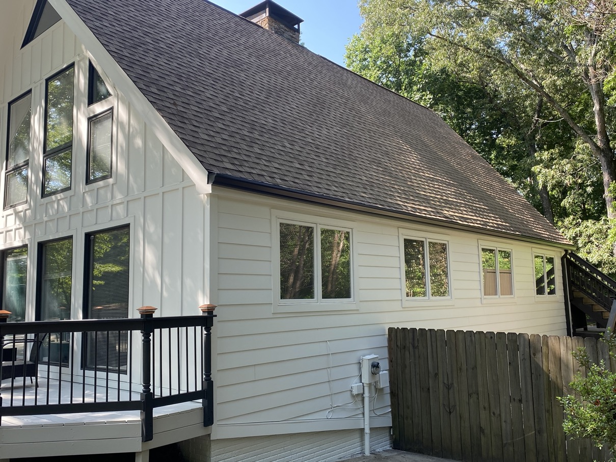 Roswell Board Batten and Smooth Siding Home Multiple windows and deck