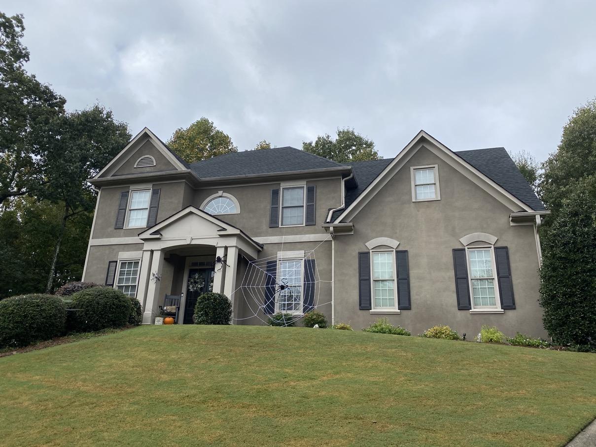 Cumming GA gray stucco front of house