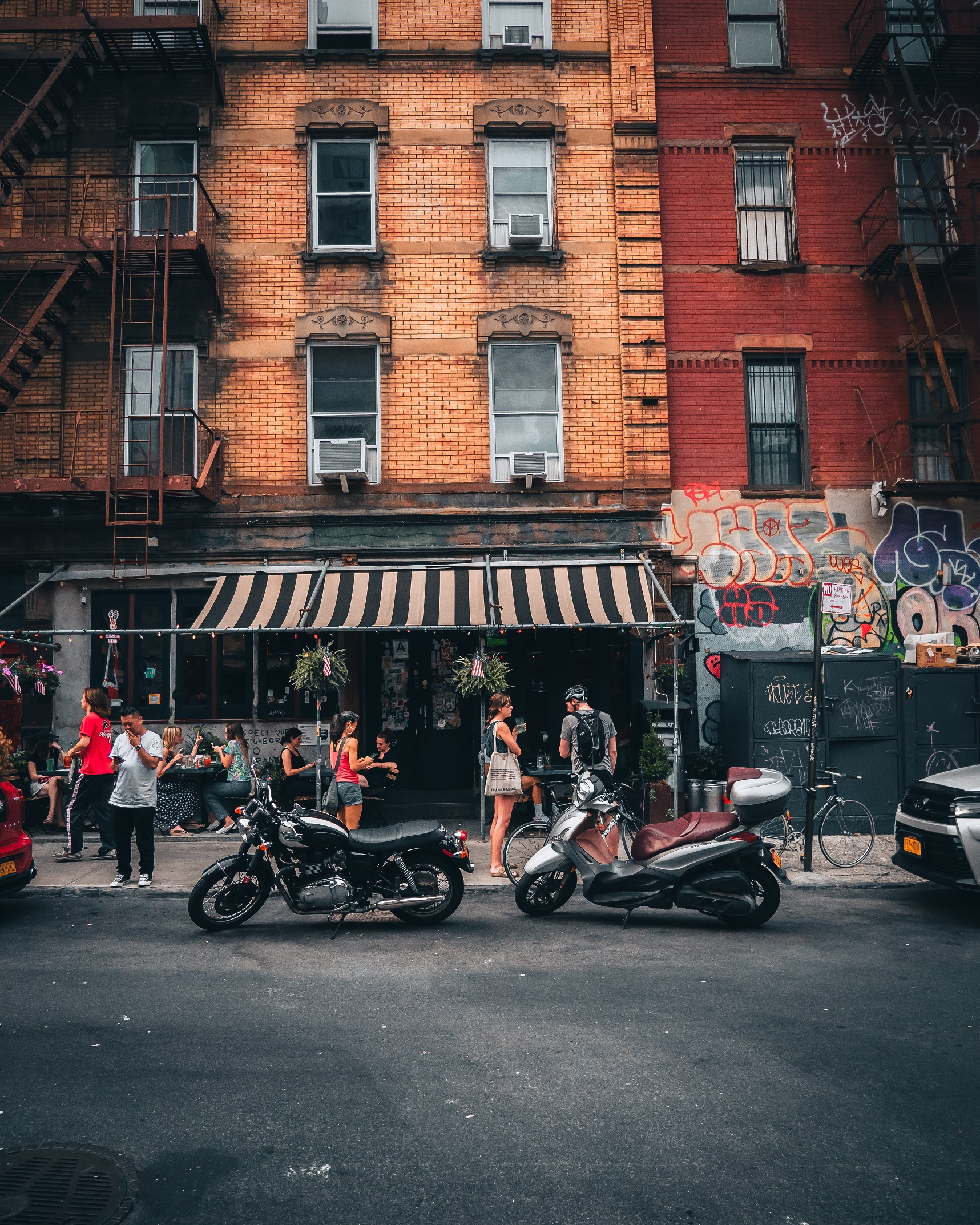 Two motorcycles parked in front of cafe in Manhattan, New York