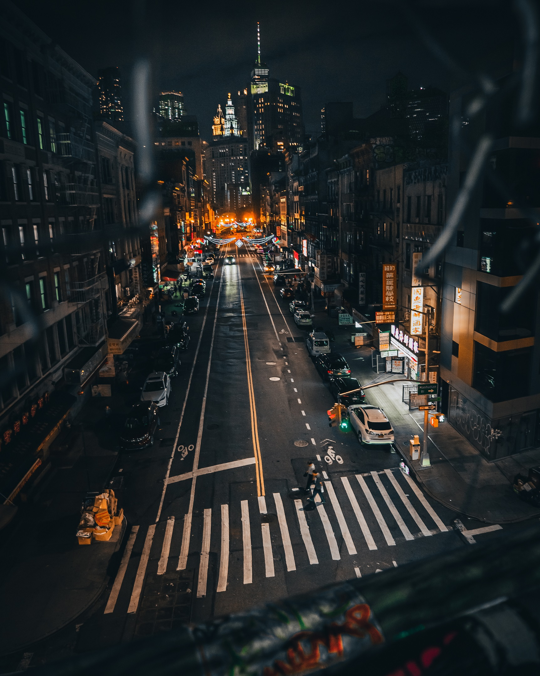 Overlooking a street in Chinatown at night in New York City