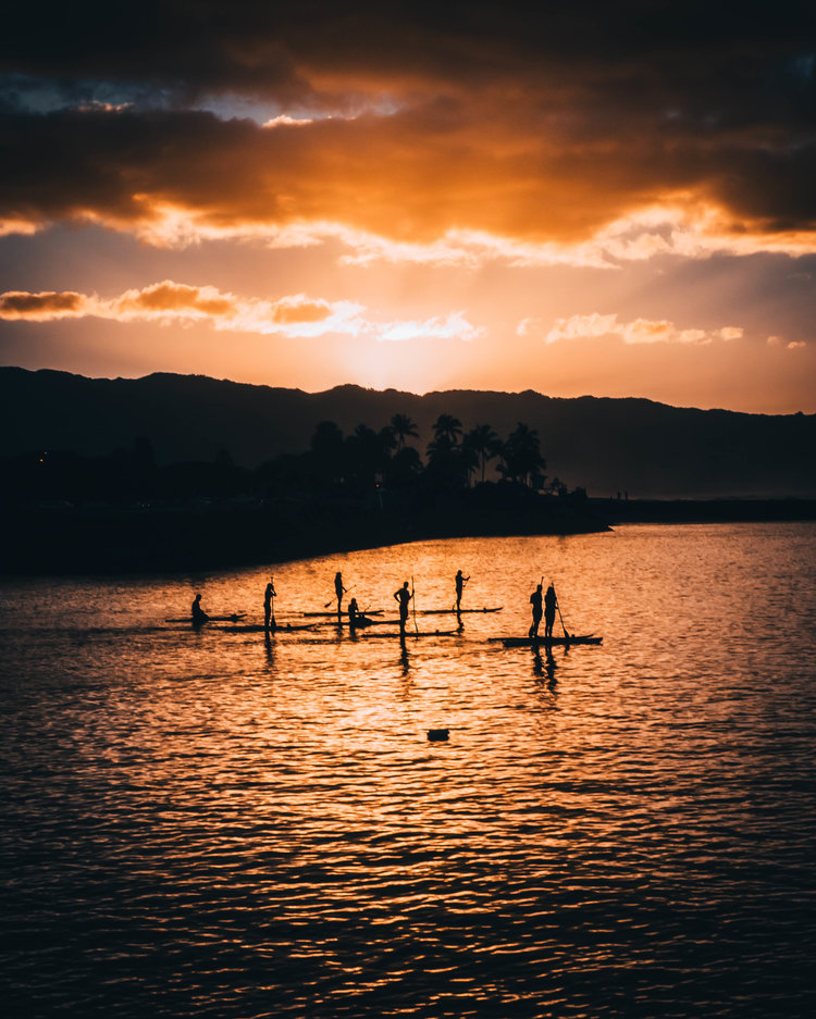 Stand-up paddleboards in the water during sunset at North Shore, Oahu, Hawaii