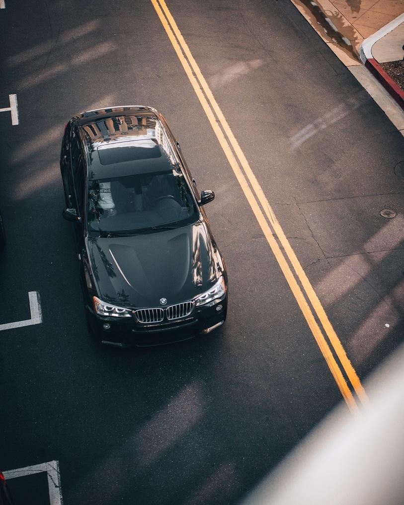 Overhead view of black BMW in Long Beach, California