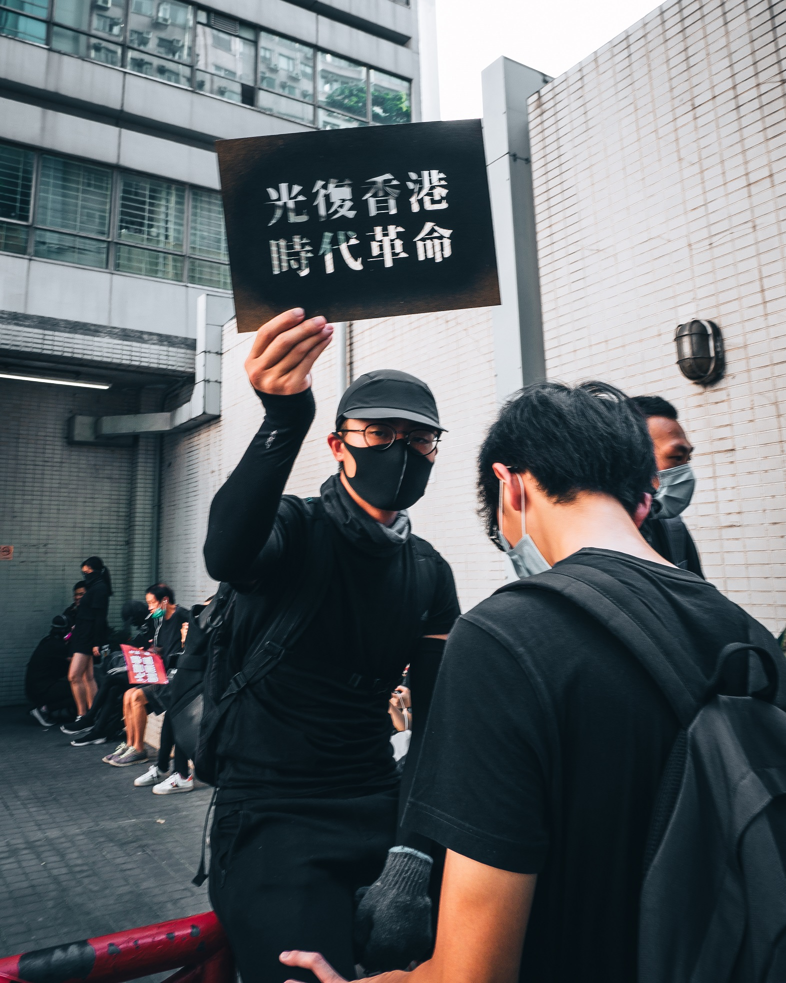 Male protester holding sign in Hong Kong