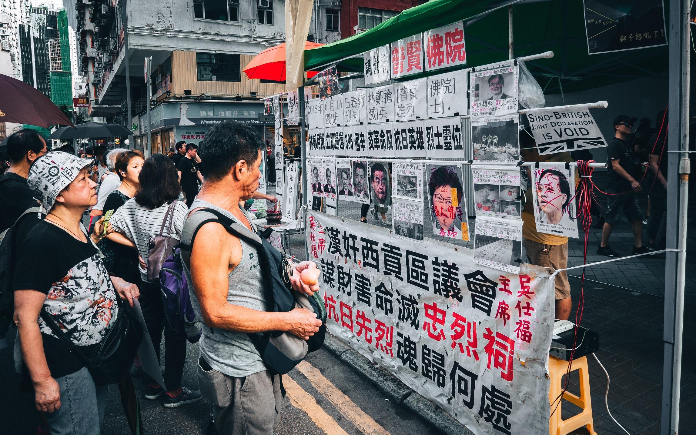Man reading protest signs in Hong Kong
