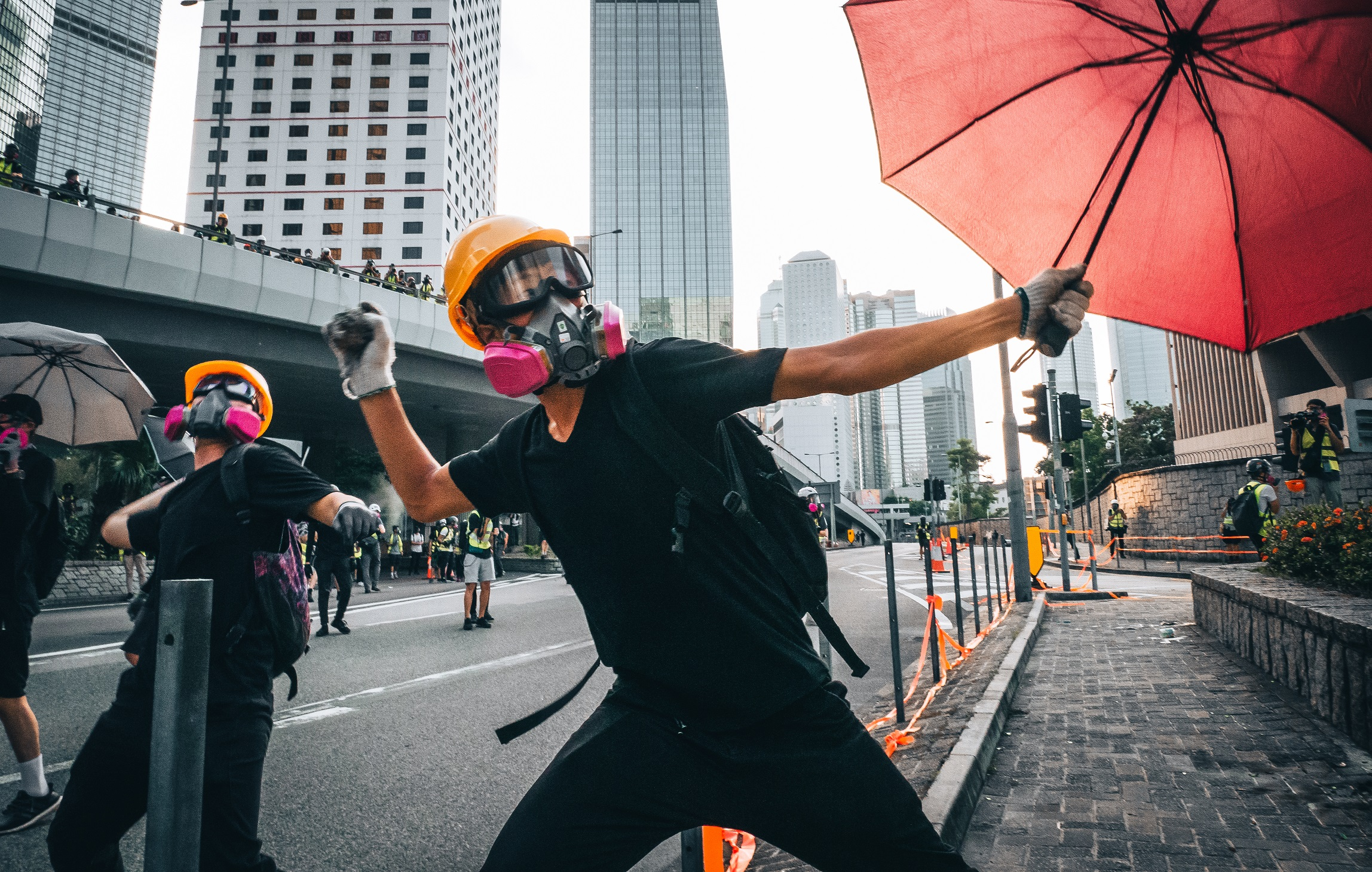 Man hold protest poster in Central, Hong Kong