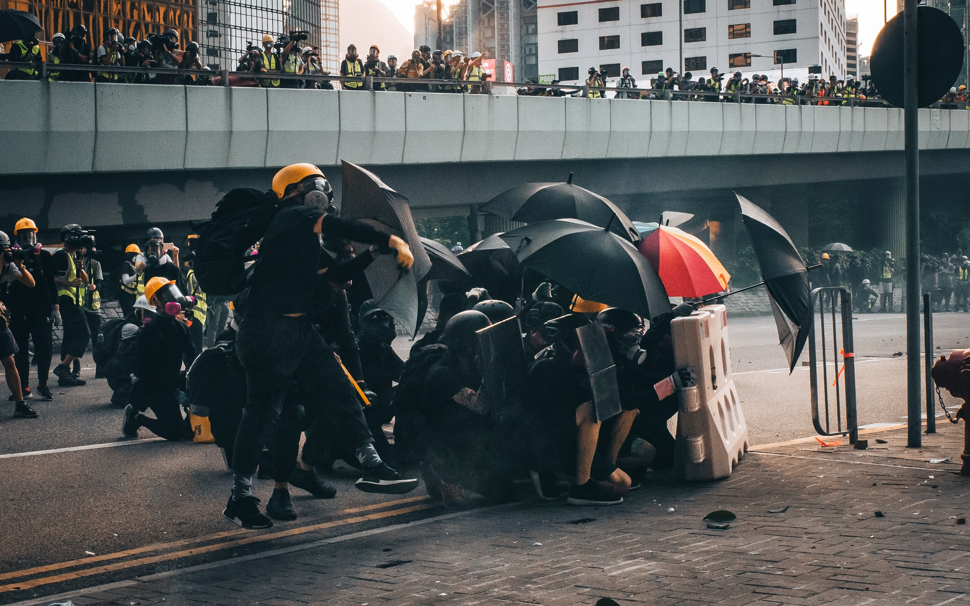 A group of protesters using umbrellas to form a shield in Central, Hong Kong