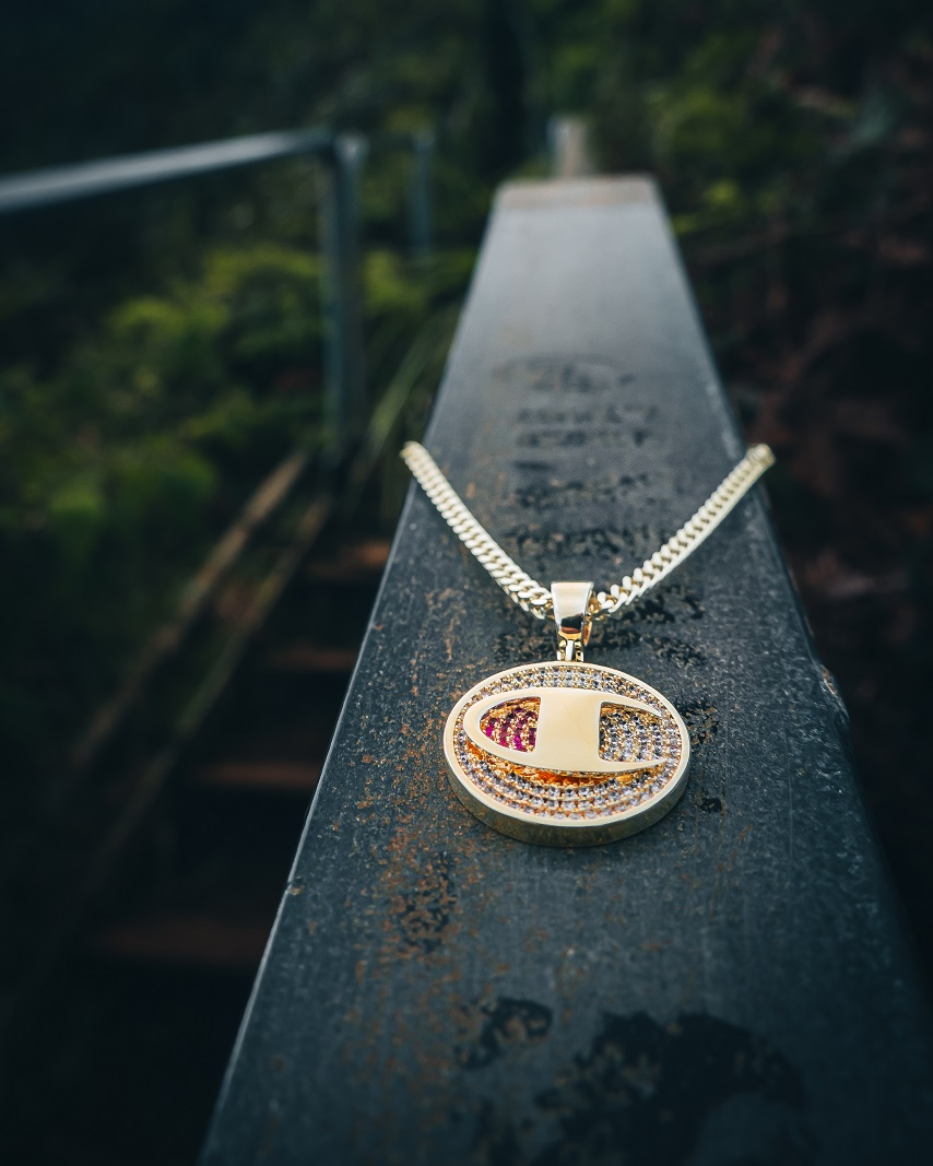 champion gold pendant necklace at the stairway to heaven in oahu, hawaii