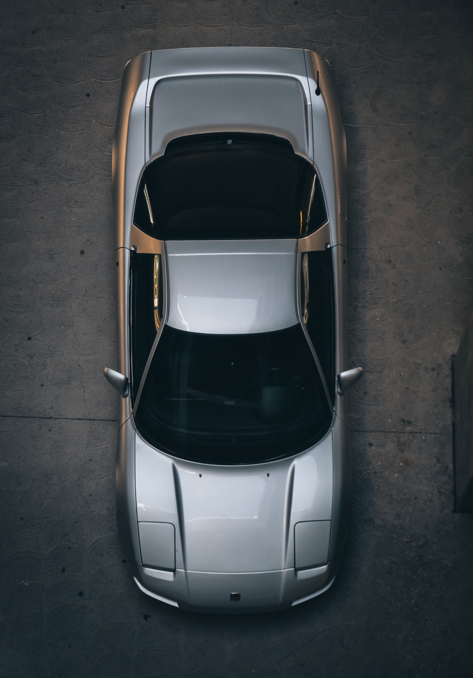 top view of a silver acura nsx