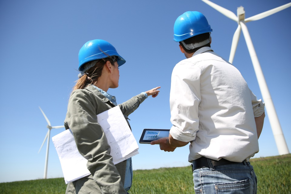 Business people working in turbine field.
