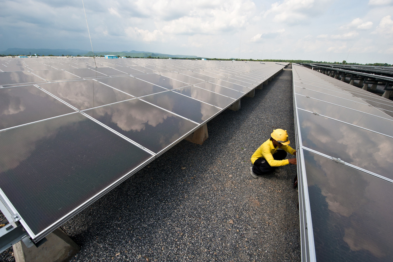 Technician checks on the solar panels installed at the Lopburi Solar Power Plant.