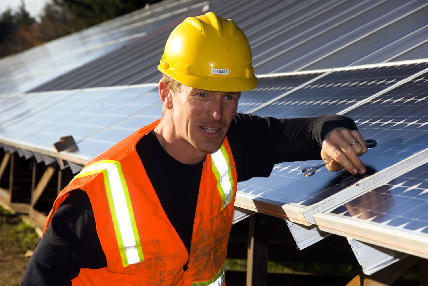 A worker checks to the alignment of a solar panel prior to installation (Nov. 26, 2008)