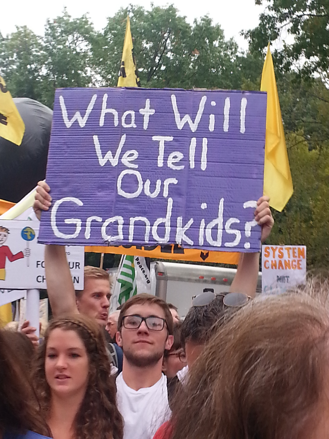 "Sign at the Climate March: ""What will we tell our grandkids?"""