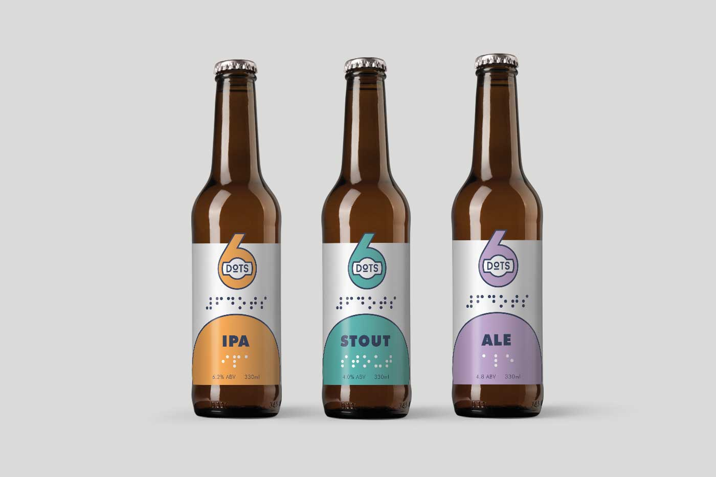three beer bottles with branded labels