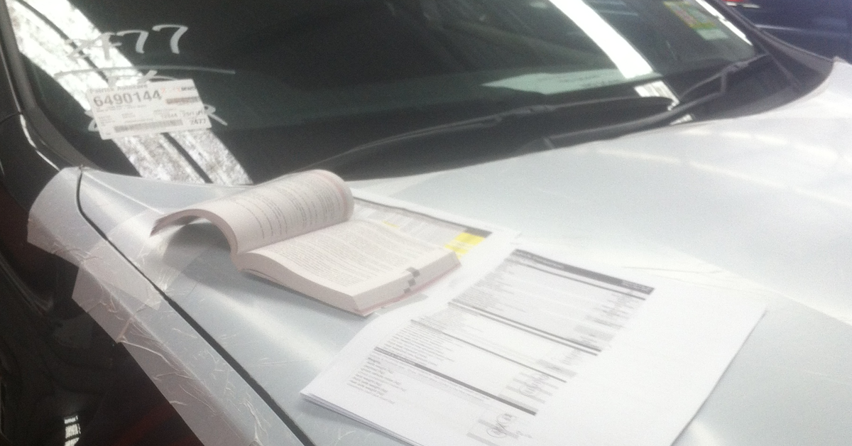 Old paper-check with printed lists over vehicle