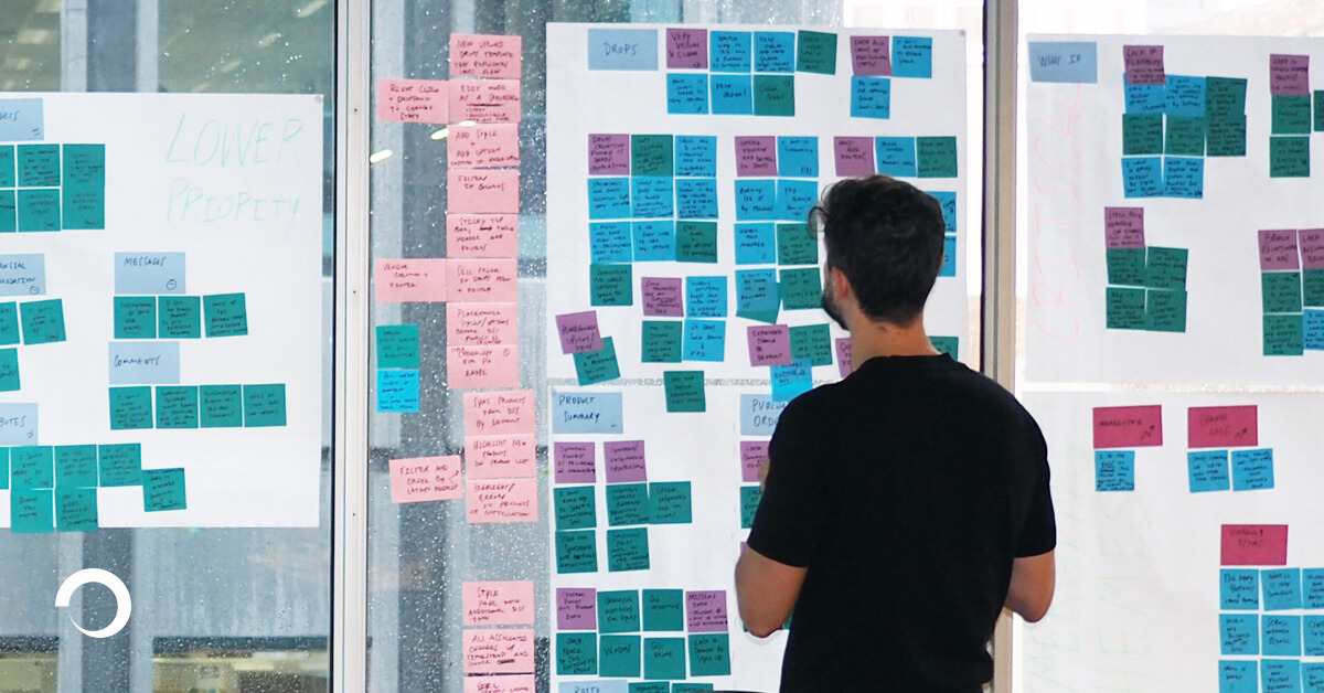 UX Consultant in front of a wall with mapped out problem areas