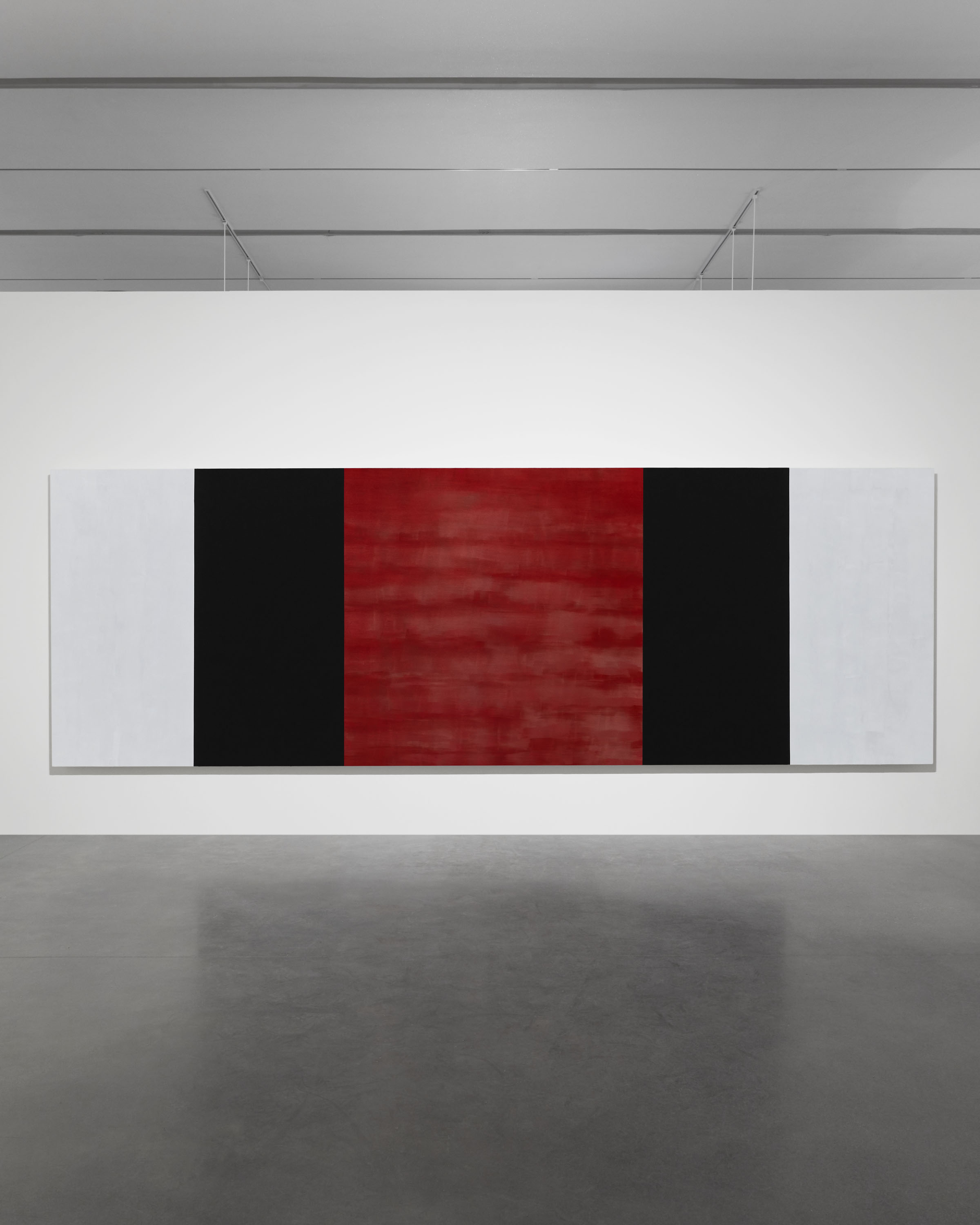 "Untitled (White, Black, Red, Beveled), 2019 glass microspheres in acrylic on canvas 78"" × 19' 6"" × 4"" (198.1 cm × 594.4 cm × 10.2 cm) Courtesy Pace Gallery"