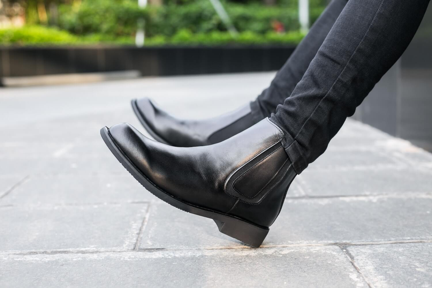 Wearing Black Chelsea Boots and Skinny Black Jeans in Courtyard