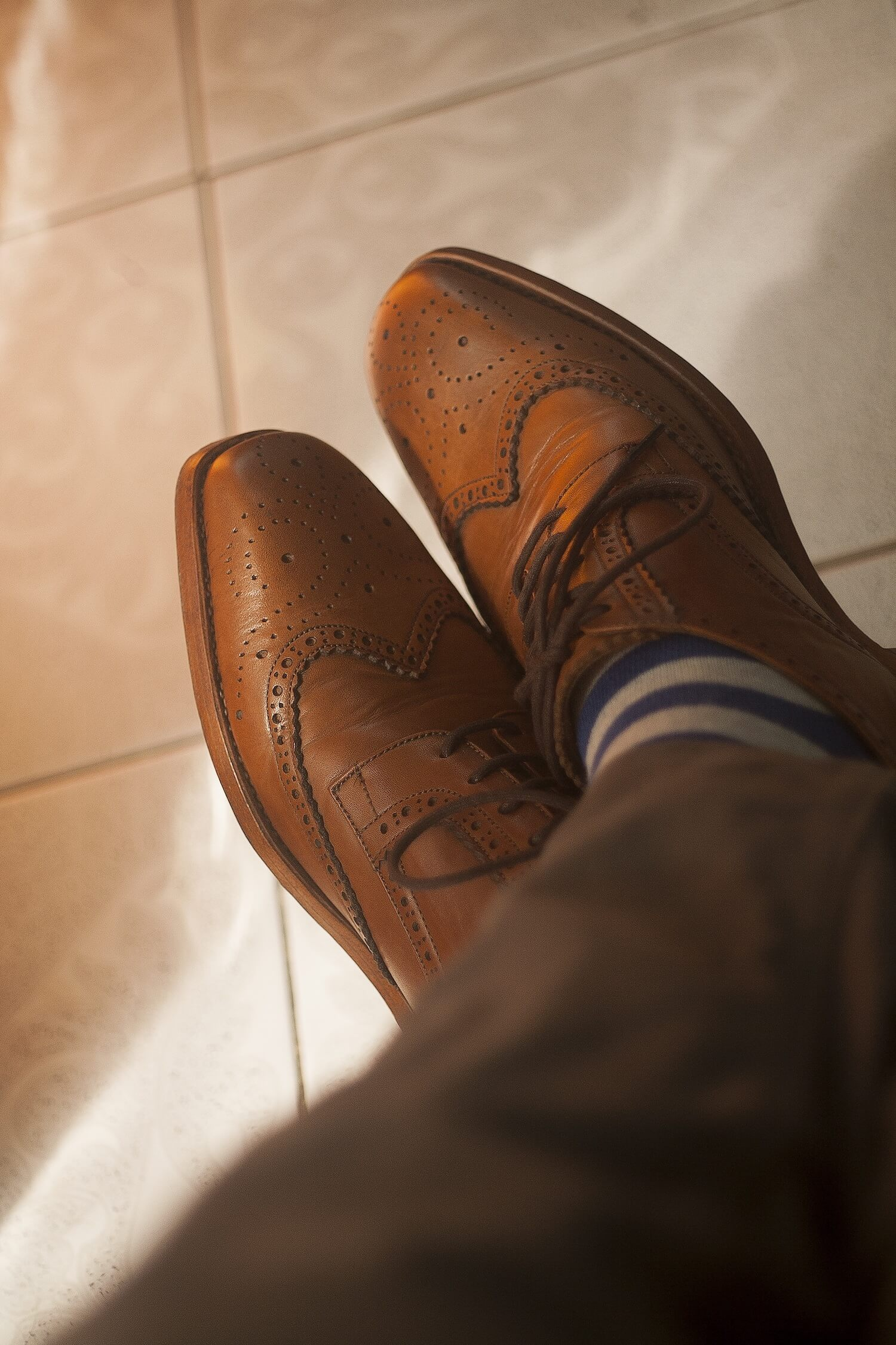 Shoe with a Wingtip Design along the toe and lots of Brogue Detailing