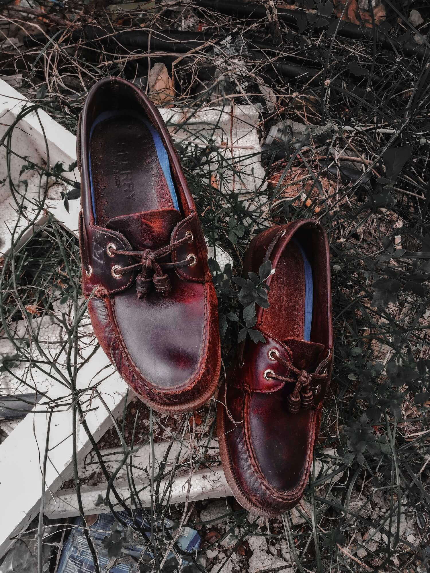 Rugged Brown Leather Loafers Sitting on Twigs