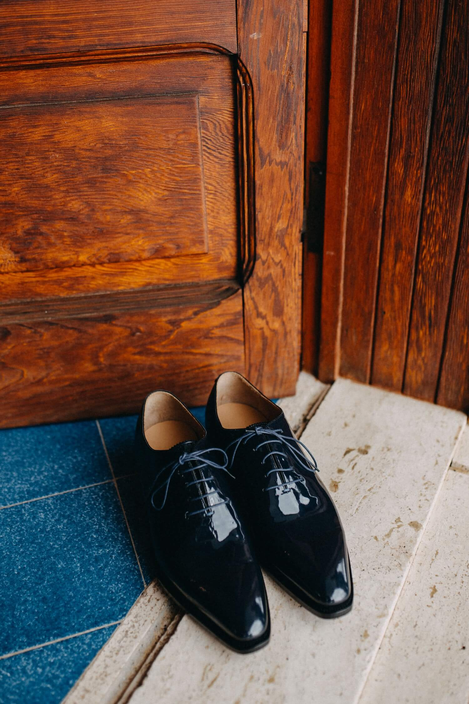 Very Polished Black Shoes With NoSeams Sitting at the Front Door