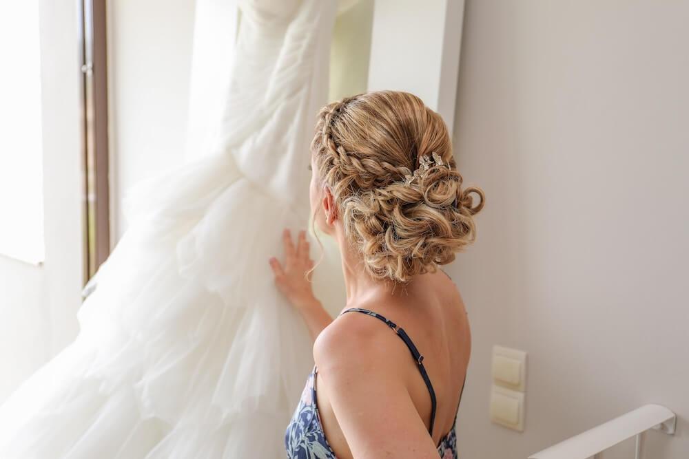 Woman touching wedding dress