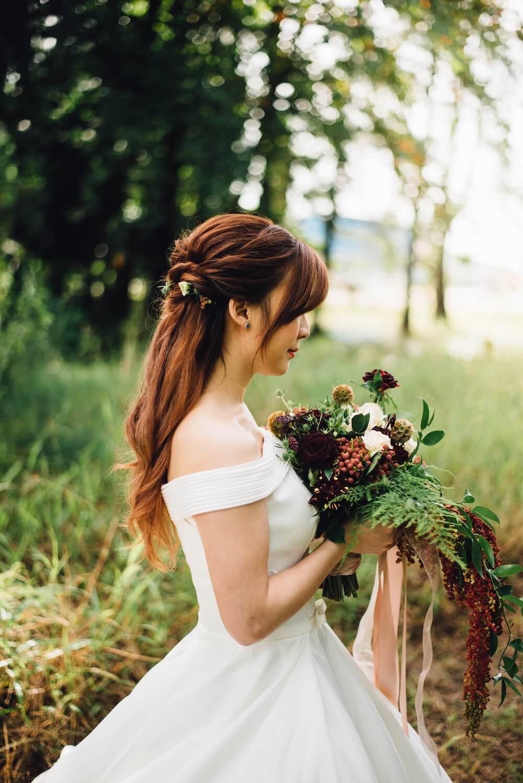 Woman holding large wedding bouquet