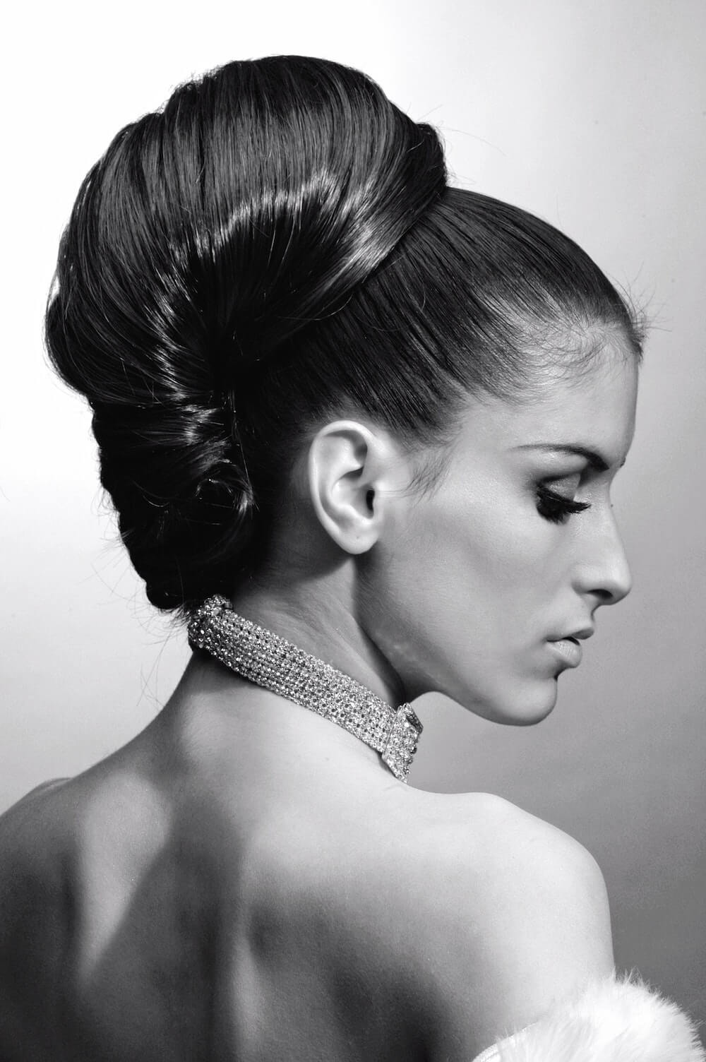 Black and white photo of woman with sleek hairstyle