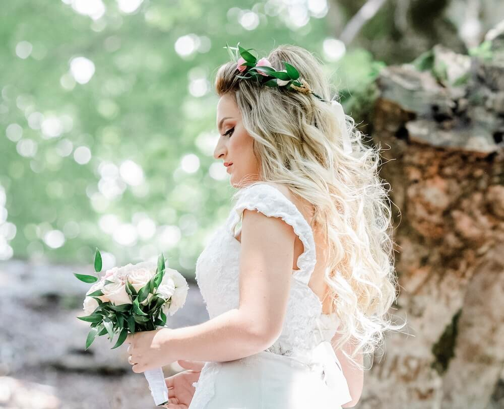 Woman walking holding wedding bouquet