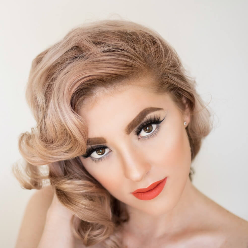 Woman with large pin curls
