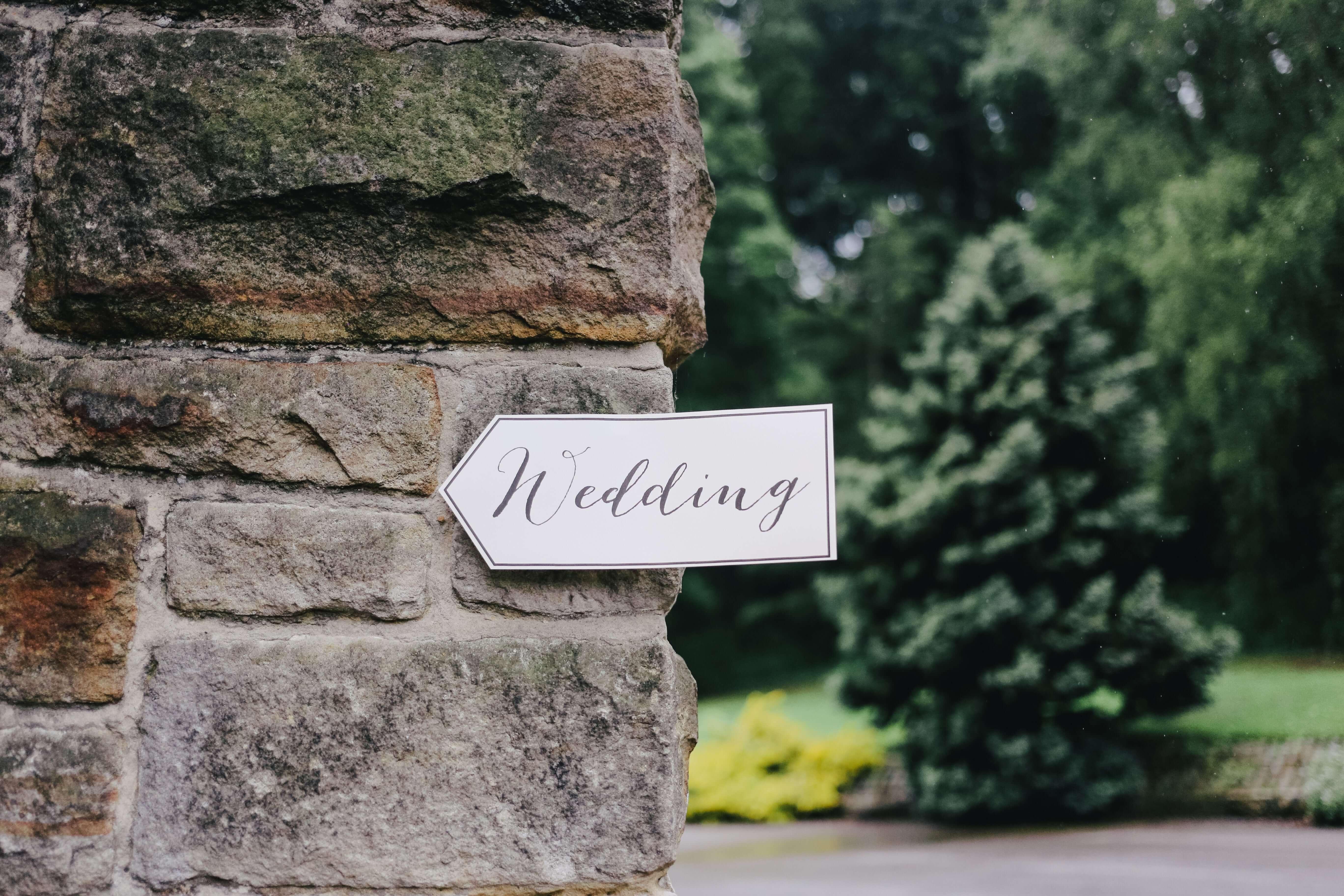 Wedding sign on stone wall
