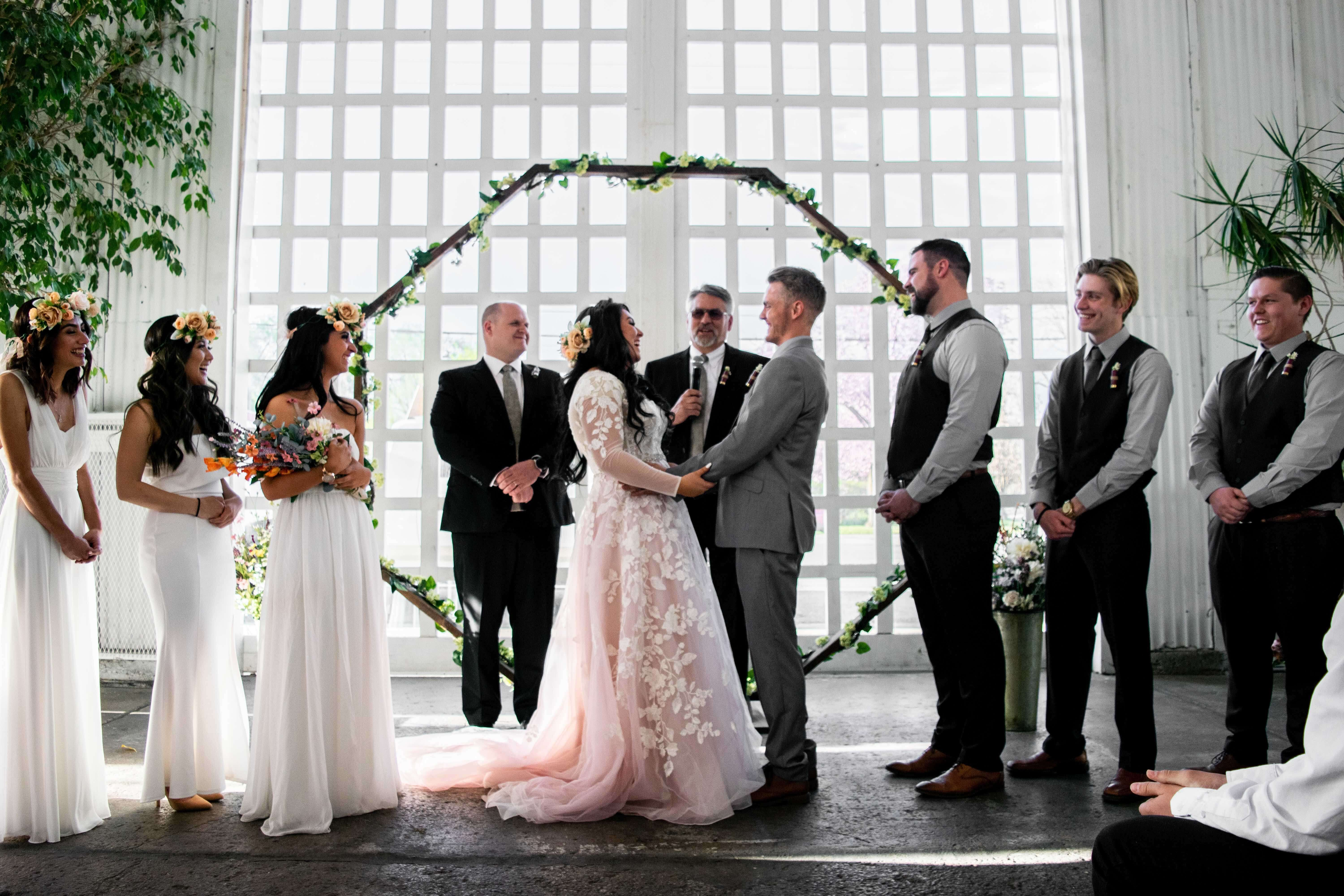 Bridal party standing at octagonal altar indoors