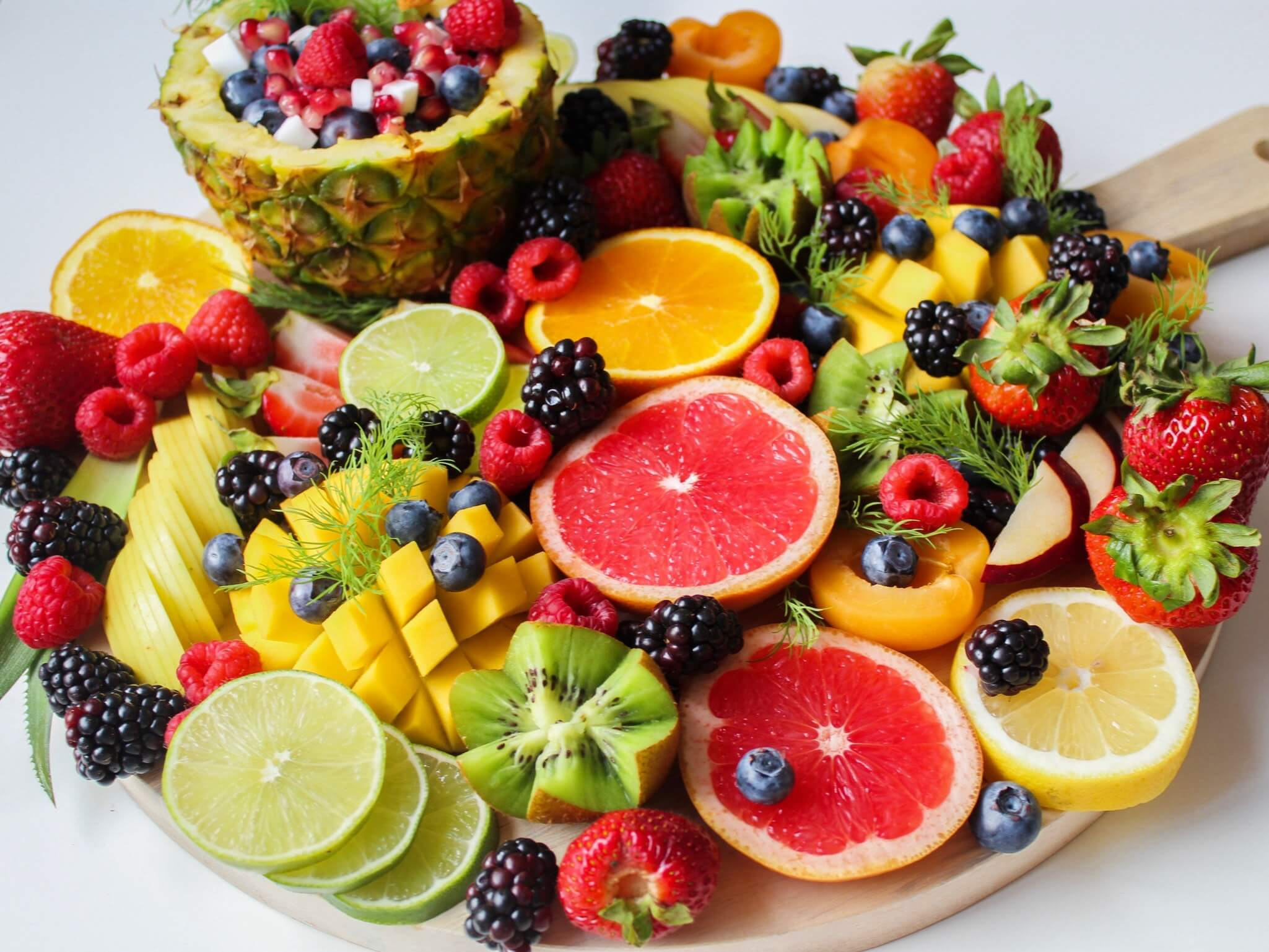 Colourful sliced fruits on tray