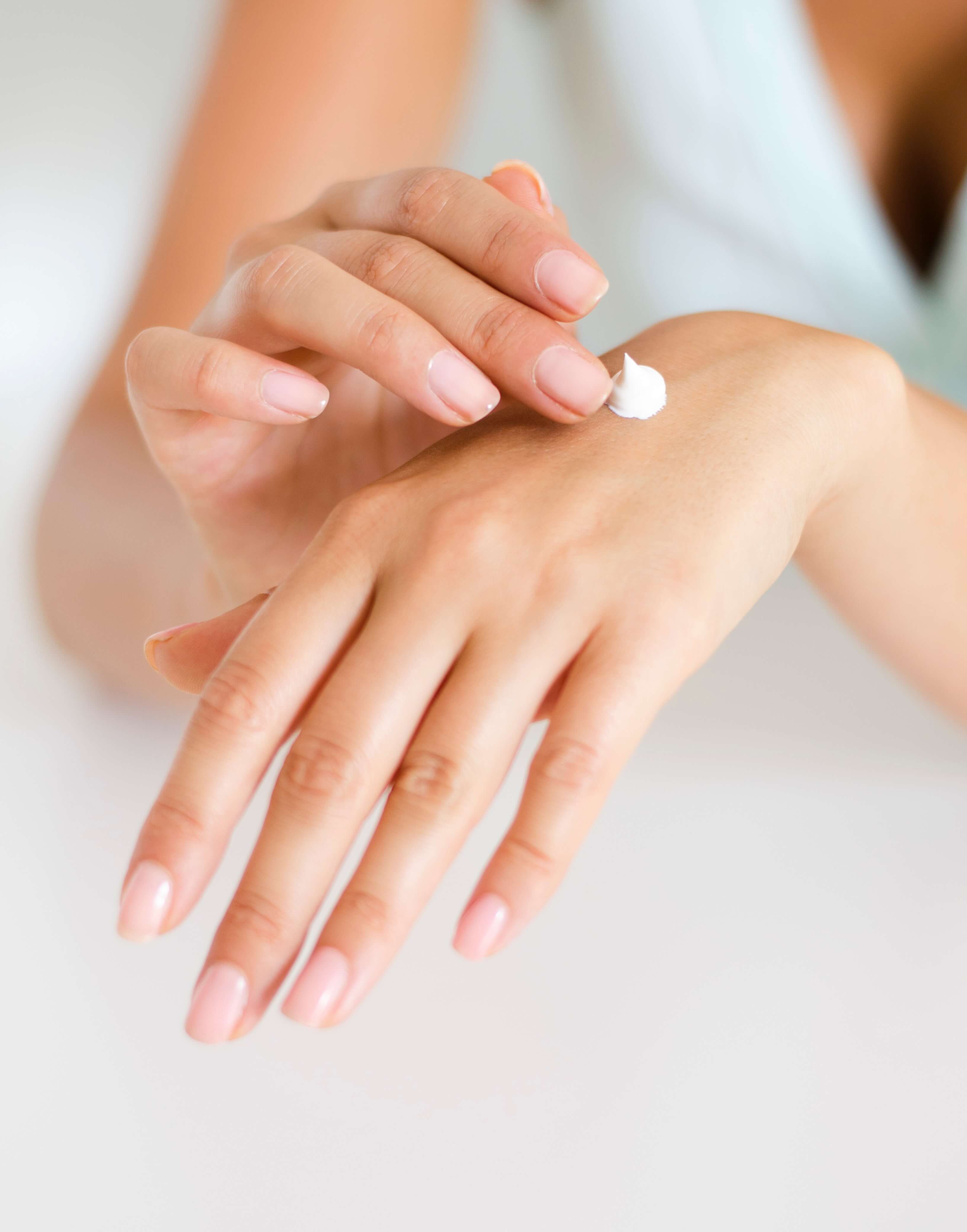 Applying body lotion to hands