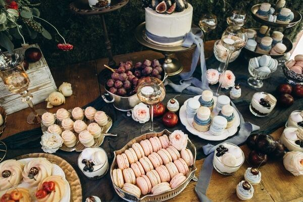 Table spread with sweet baking and fruit