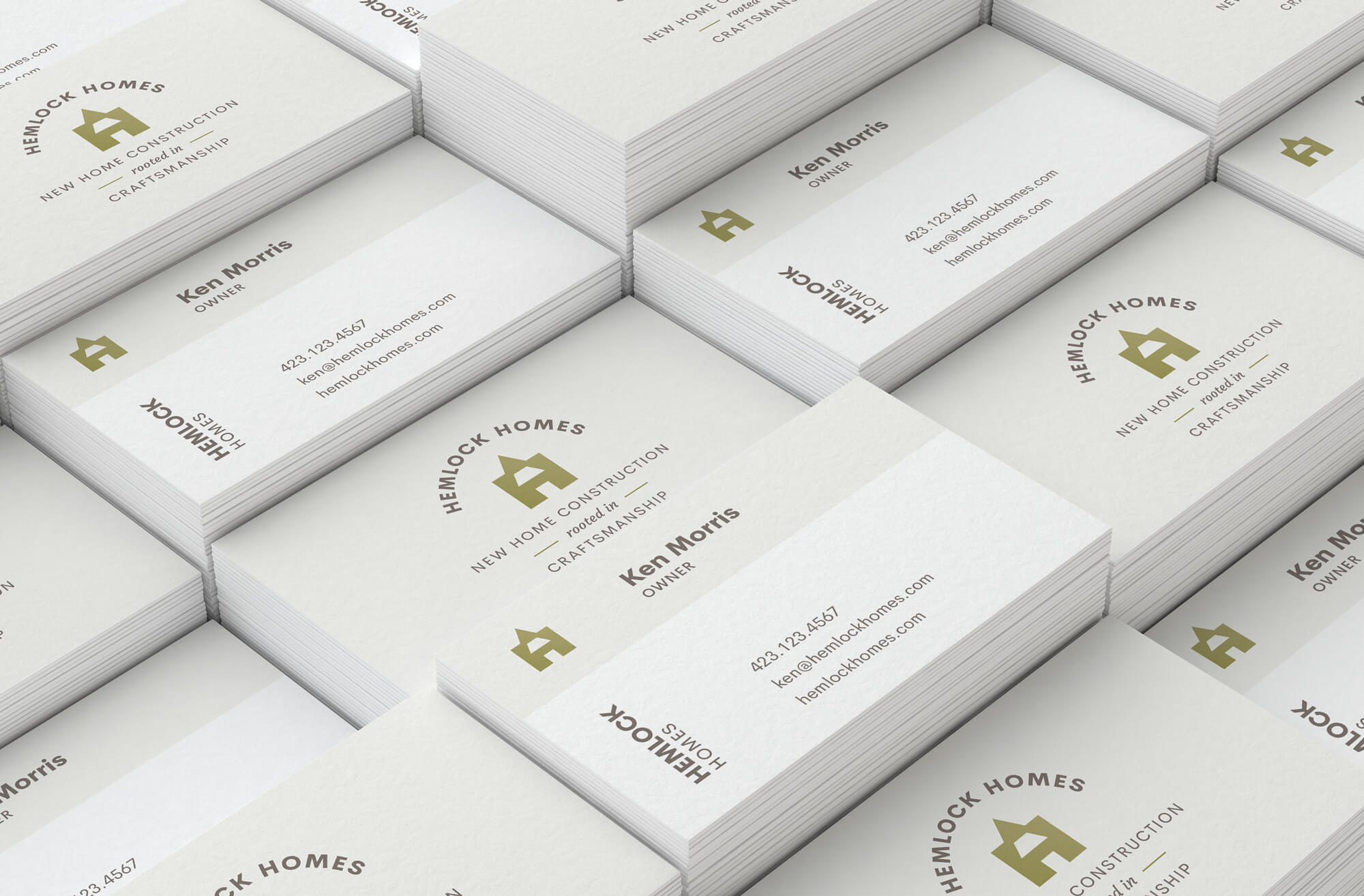 Business card mockups for Hemlock Homes, designed by Serve