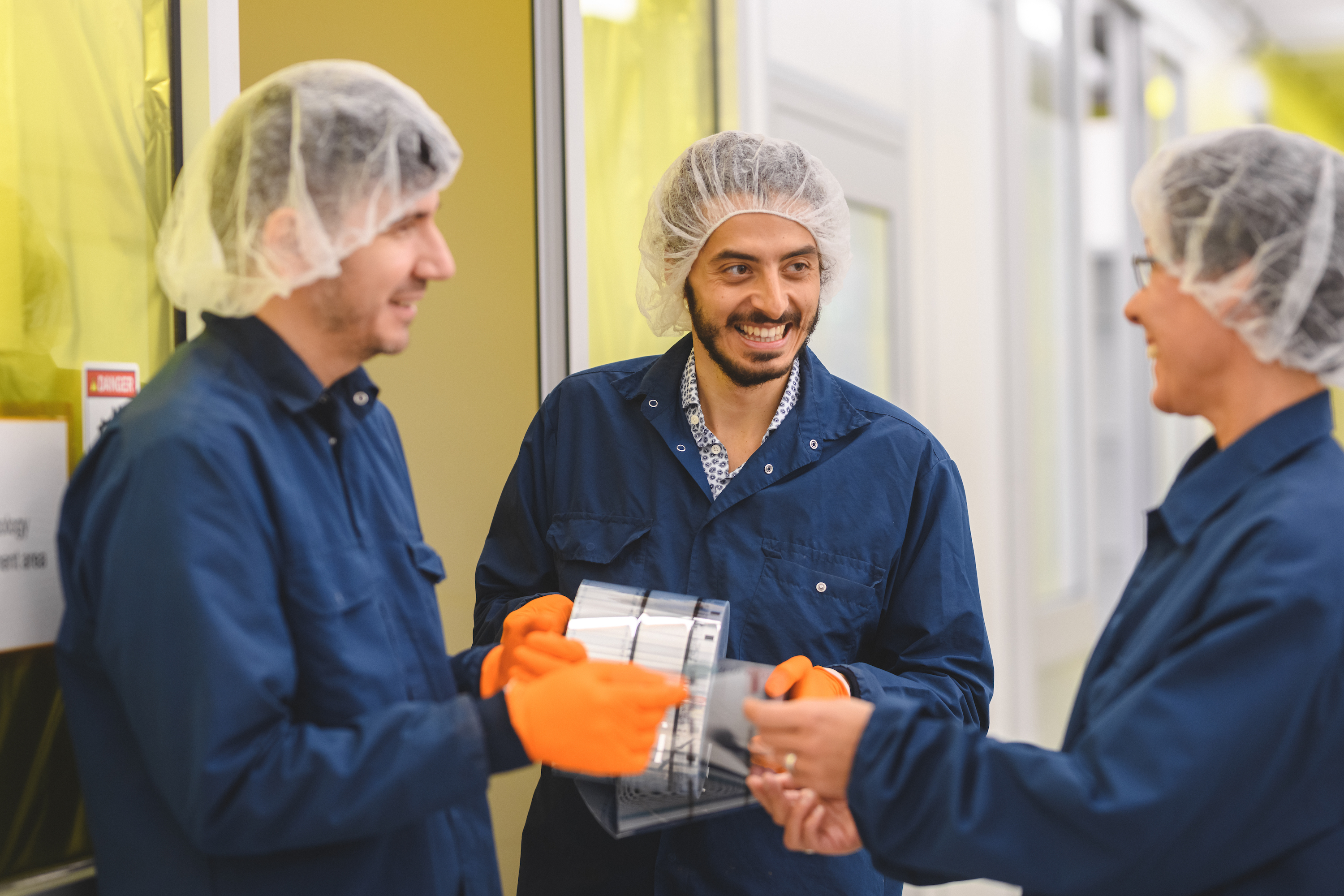 Image of people holding solar cell film